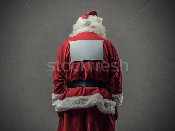 Kerstman Maakt een reservekopie naar beneden te kijken achteraanzicht teken Stockfoto © stokkete