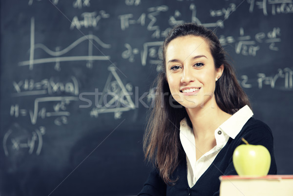 Portrait of a young woman, teacher in front of a blackboard Stock photo © stokkete