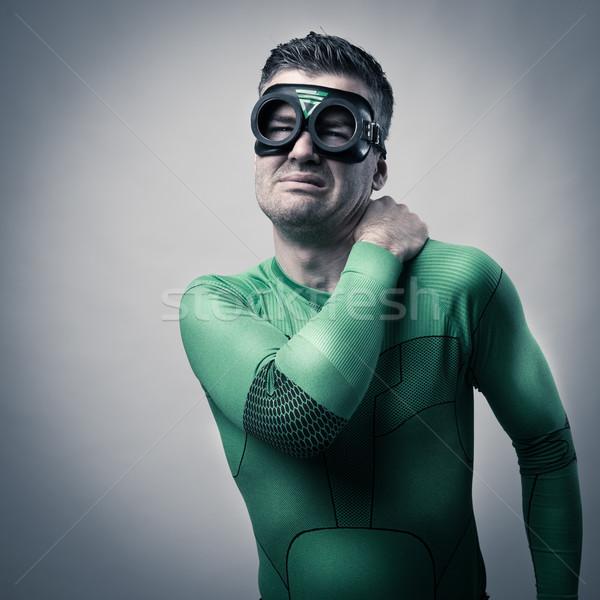Superhero with stiff neck Stock photo © stokkete