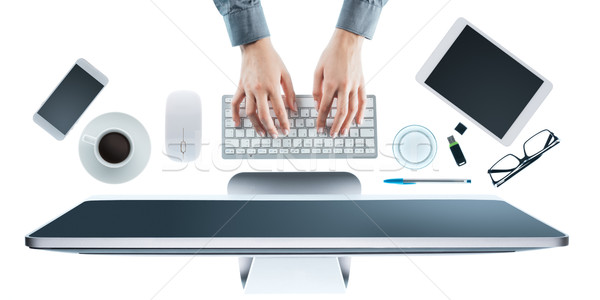 Business woman working at office desk Stock photo © stokkete