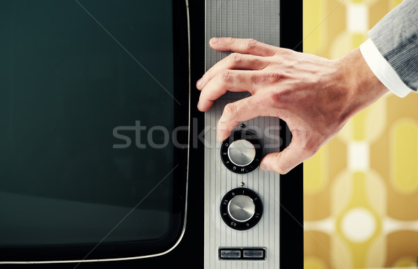 Man  turning channel knob on retro television  Stock photo © stokkete