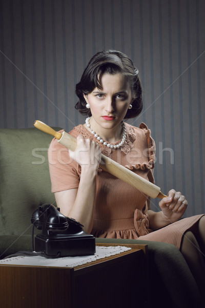Mérges feleség vár férj sodrófa kéz Stock fotó © stokkete