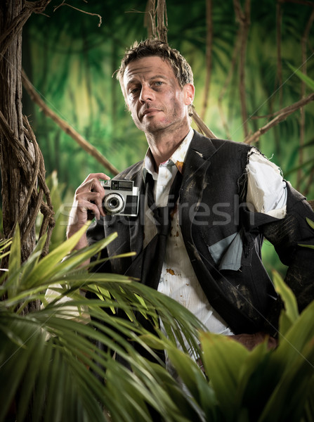 Photoreporter walking in the jungle with vintage camera Stock photo © stokkete