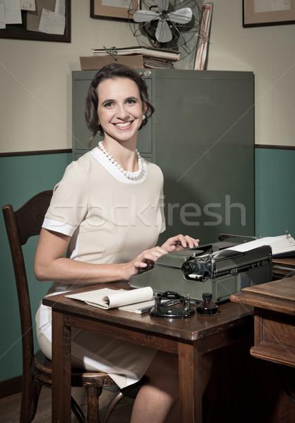 Fiatal klasszikus titkárnő munka mosolyog iroda Stock fotó © stokkete
