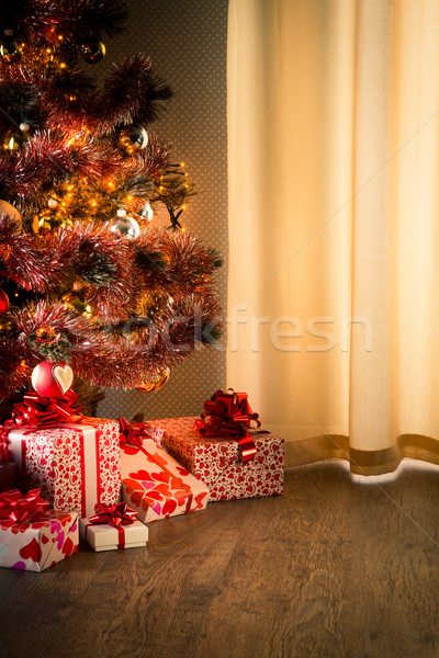 Christmas eve with colorful tree and gifts Stock photo © stokkete