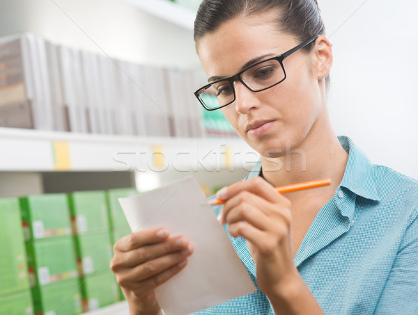 Attractive woman with shopping list Stock photo © stokkete
