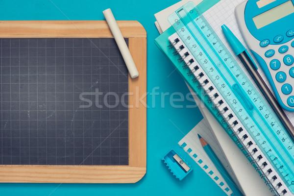 Quadro-negro artigos de papelaria azul giz luz azul escolas Foto stock © stokkete
