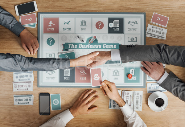 Business people playing a board game Stock photo © stokkete