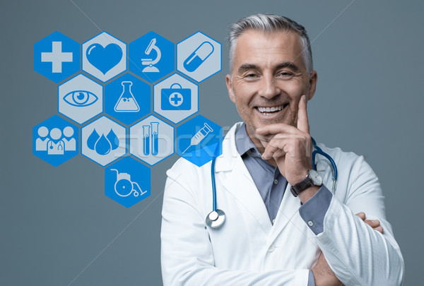 Confident doctor and medical icons Stock photo © stokkete