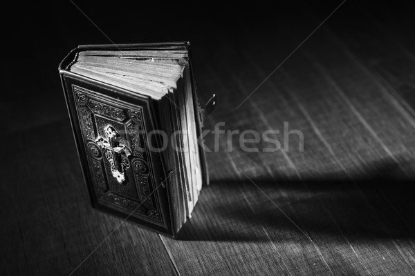 Precious antique Bible on a wooden desktop Stock photo © stokkete