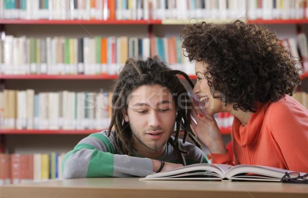 Secrets potins deux bibliothèque étudiant Photo stock © stokkete