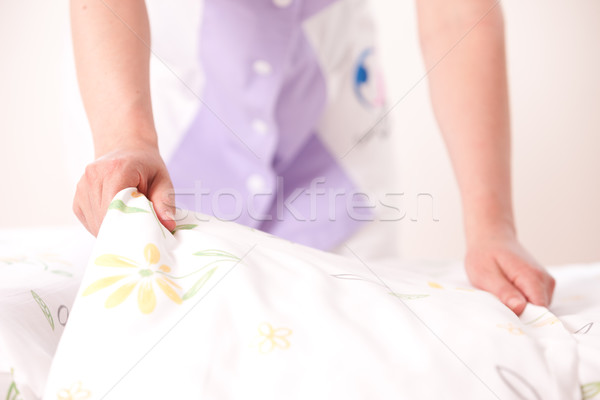 Woman making bed Stock photo © stokkete