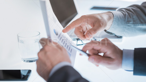 Businessmen examining a financial report Stock photo © stokkete