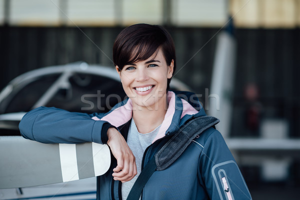 Confident female pilot in the hangar Stock photo © stokkete