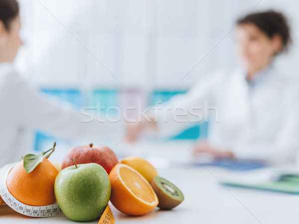 Nutritionist meeting a patient in the office Stock photo © stokkete