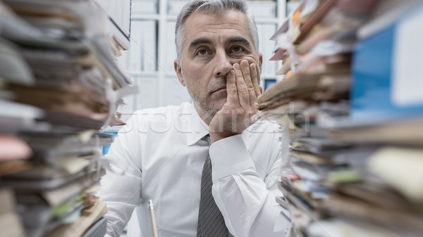 Frustrated executive overloaded with paperwork Stock photo © stokkete