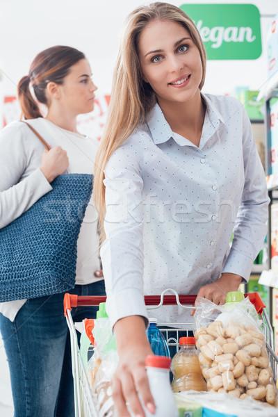 Girls shopping at the supermarket Stock photo © stokkete