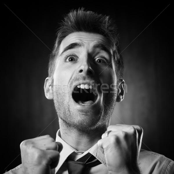 Una buena noticia excitado joven empresario Foto stock © stokkete