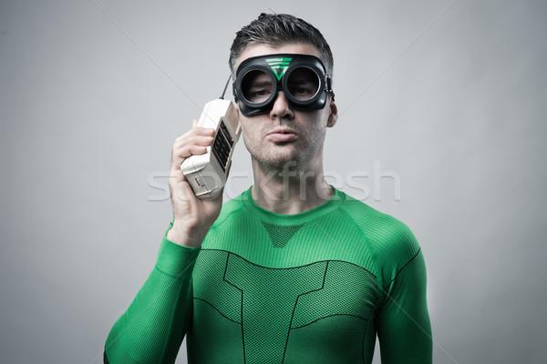 Superhero on the phone Stock photo © stokkete