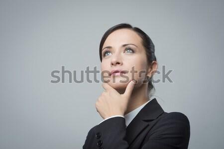 Pensativo mujer de negocios mano barbilla atractivo mujer de negocios Foto stock © stokkete
