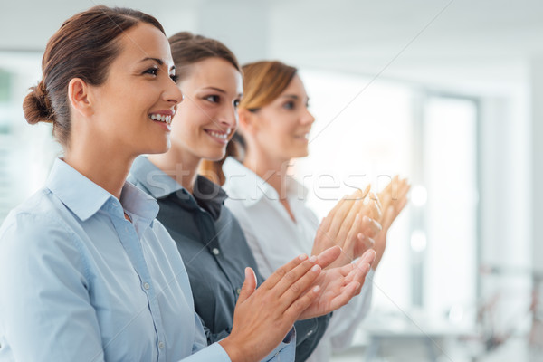 Cheerful business women applauding Stock photo © stokkete