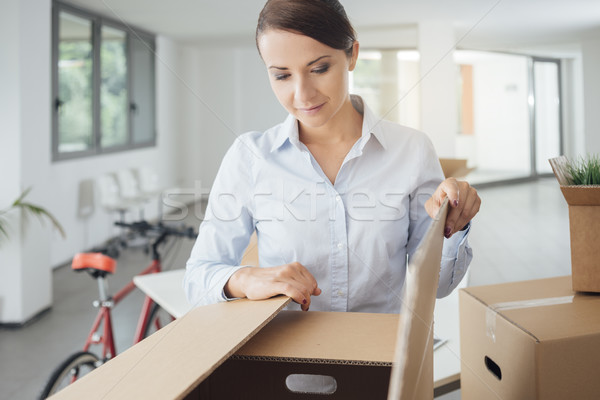 Happy woman unpacking Stock photo © stokkete