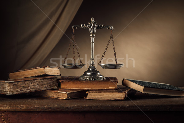 Old silver scale and books still life Stock photo © stokkete
