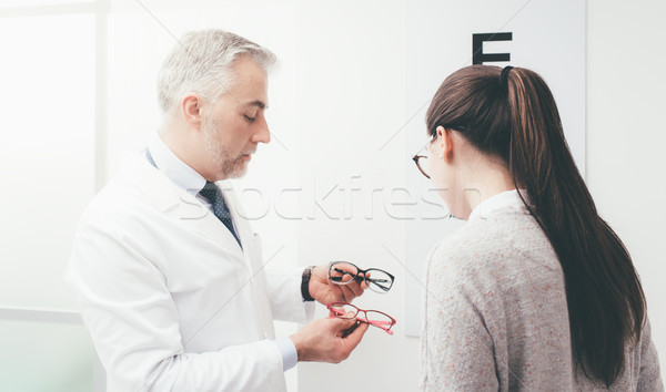 Woman choosing a pair of glasses Stock photo © stokkete