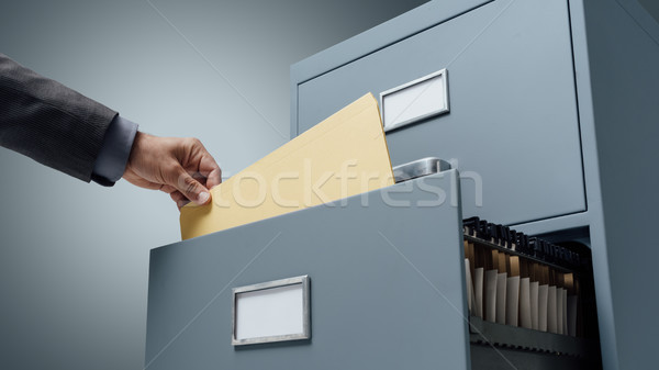 Office clerk searching files Stock photo © stokkete