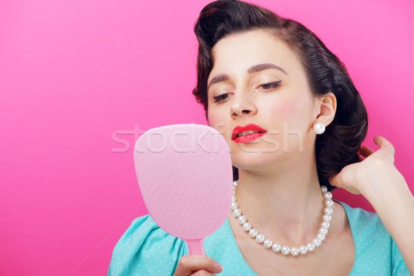 Vanità guardando faccia specchio donne Foto d'archivio © stokkete