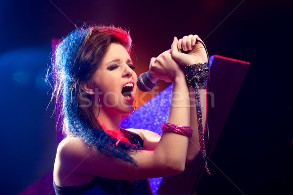 Pop star singing on stage Stock photo © stokkete