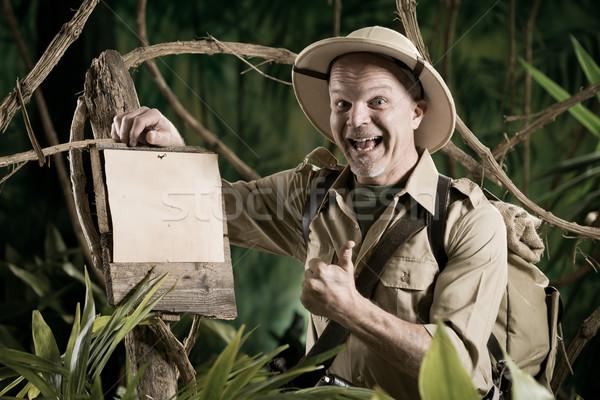 Alegre explorador assinar floresta Foto stock © stokkete