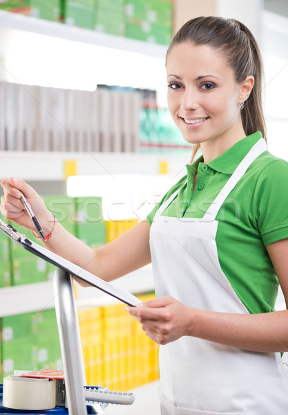 Supermarket worker with clipboard Stock photo © stokkete