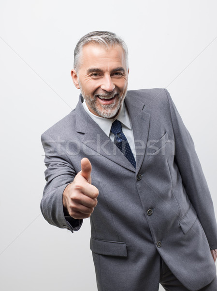 Confident business executive giving a thumbs up Stock photo © stokkete