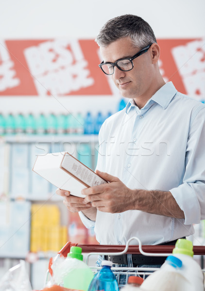 Man reading food labels Stock photo © stokkete