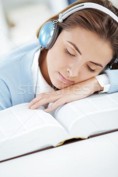 Sleeping on open book Stock photo © stokkete