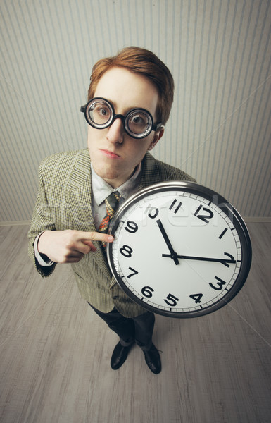 A nerdy guy with a giant-sized clock Stock photo © stokkete