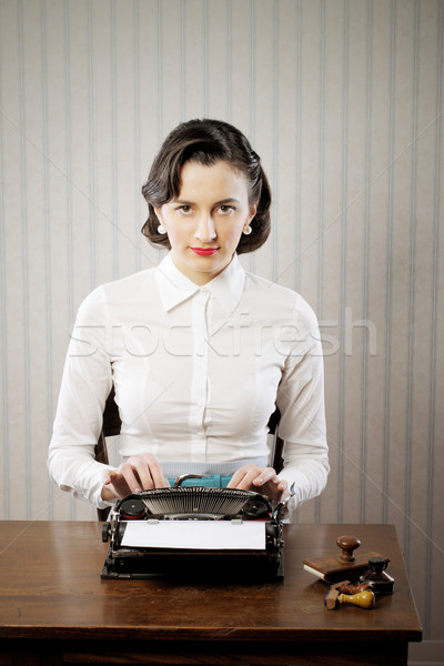 Woman typing in her office Stock photo © stokkete