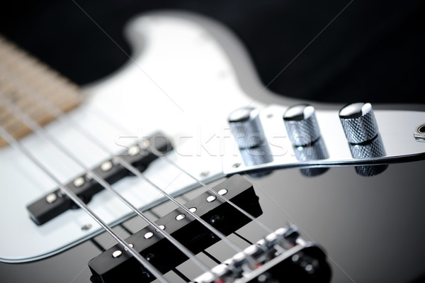 close up of a black electric bass glossy on dark background Stock photo © stokkete