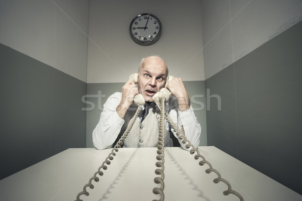 Overworked businessman on the phone Stock photo © stokkete