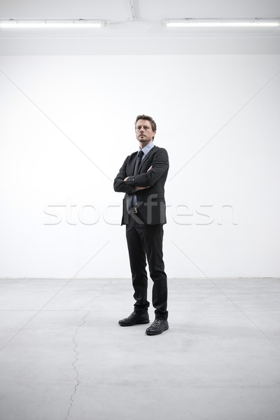 Confident businessman with arms crossed Stock photo © stokkete