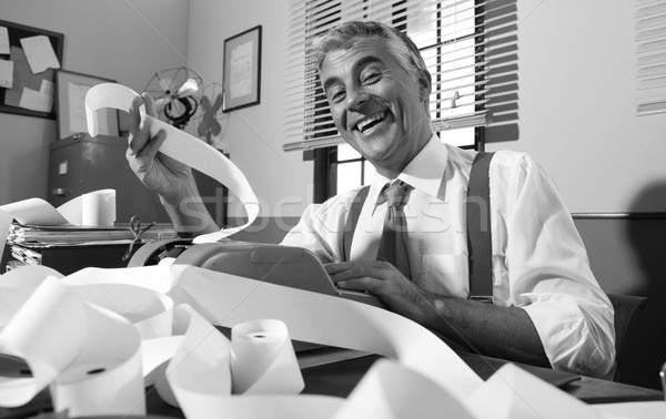 Cheerful vintage accountant surrounded by bills Stock photo © stokkete