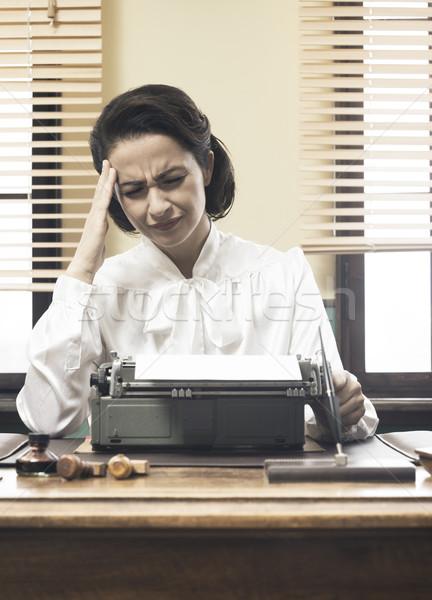 Vintage secretary with headache Stock photo © stokkete