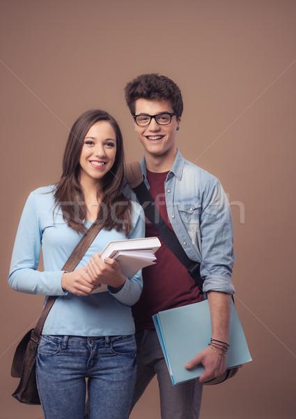 Stock fotó: Boldog · tinédzser · diákok · tart · tankönyvek · mosolyog