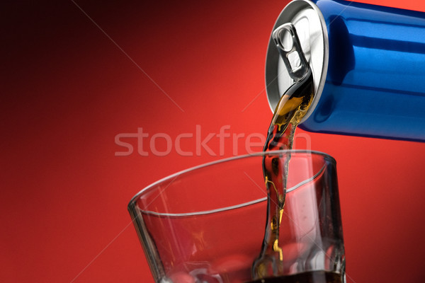 Pouring a soft drink in a glass Stock photo © stokkete