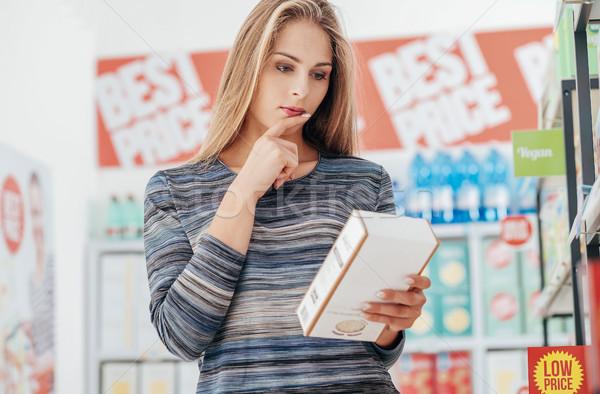 Foto stock: Mulher · leitura · comida · mulher · jovem · mercearia