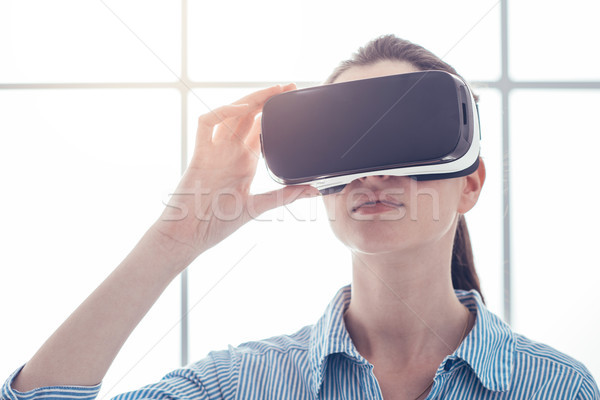 Young woman experiencing virtual reality Stock photo © stokkete