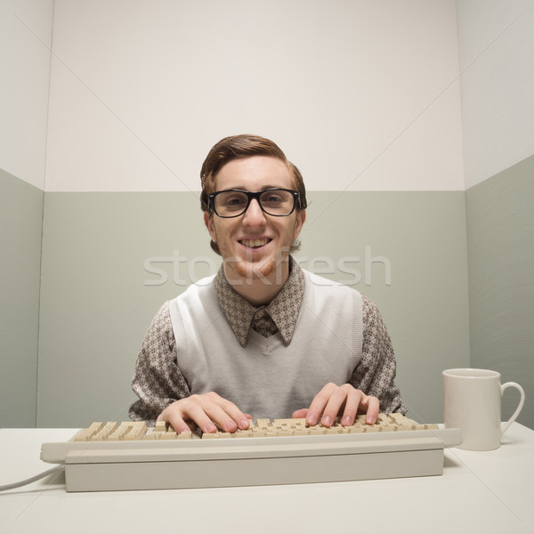 Vintage nerd on computer Stock photo © stokkete