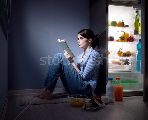Sleepless woman reading in the kitchen Stock photo © stokkete