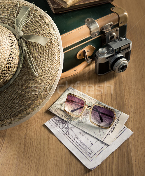 Traveler with vintage camera and maps Stock photo © stokkete